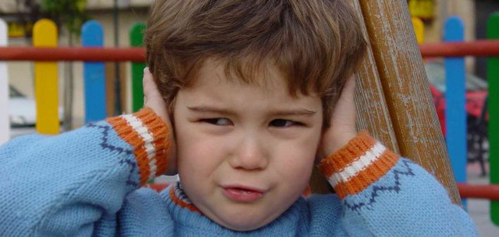 Photo-of-child-covering-ears-tinnitus-General-Hearing-Instruments